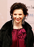 Actress JULIETTE BINOCHE poses for the media as she arrives at 23rd European Film Awards