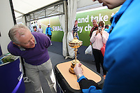 Visitors to the Visit Scotland stand on the tented village get close up view of the Ryder Cup during the final round of the 2013 ISPS Handa Wales Open from the Celtic Manor Resort, Newport, Wales. Picture:  David Lloyd / www.golffile.ie