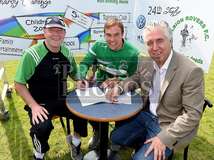 FAI President John Delaney signs Louth player Conor Grimes with Liam Callan from Albion Rovers. Photo:Colin Bell/pressphotos.ie
