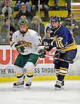 16 February 2008: University of Vermont Catamounts' forward Brian Roloff, a Sophomore from West Seneca, NY, skates alongside Merrimack College Warriors' defenseman Brandon Sadlowski, a Sophomore from St. Paul, Alberta, at Gutterson Fieldhouse in Burlington, Vermont. The Catamounts defeated the Warriors 2-1 for their second win of the 2-game weekend series...Mandatory Photo Credit: Ed Wolfstein Photo