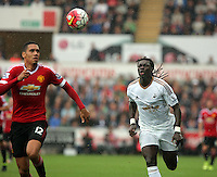 Pictured: Bafetimbi Gomis of Swansea (R) against Chris Smalling of Manchester United (L) Sunday 30 August 2015<br /> Re: Premier League, Swansea v Manchester United at the Liberty Stadium, Swansea, UK