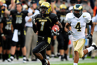 31 Aug 2008: Colorado kickoff returner Josh Smith (1) runs for a touchdown against Colorado State. Chasing smith is CSU cornerback Brandon Owens (4). The Colorado Buffaloes defeated the Colorado State Rams 38-17 at Invesco Field at Mile High in Denver, Colorado. FOR EDITORIAL USE ONLY