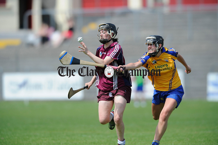 Clare's Siobhan Keniry tackles Galway's Niamh Mc Grath during their Intermediate championship game at Athentry. Photograph by John Kelly.