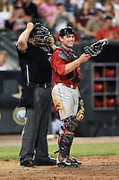Oklahoma City RedHawks catcher Max Stassi (10) talks with umpire Spencer Flynn during a game against the Memphis Redbirds on May 23, 2014 at AutoZone Park in Memphis, Tennessee.  Oklahoma City defeated Memphis 12-10.  (Mike Janes/Four Seam Images)