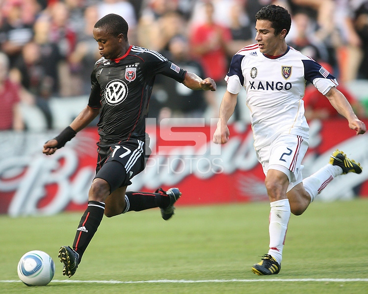 Boyzzz Khumalo #17 of D.C. United beats Tony Beltran #2  of Real Salt Lake to the ball and winds up for a shot during an Open Cup match at RFK Stadium, on June 2 2010 in Washington DC. DC United won 2-1.