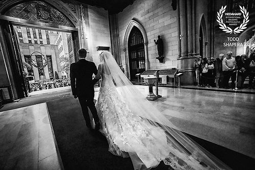 A newly married couple following their elegant ceremony at St. Patrick's Cathedral, New York.