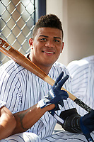 GCL Yankees East designated hitter Jonathan Amundaray (60) in the dugout during the first game of a doubleheader against the GCL Blue Jays on July 24, 2017 at the Yankees Minor League Complex in Tampa, Florida.  GCL Blue Jays defeated the GCL Yankees East 6-3 in a game that originally started on July 8th.  (Mike Janes/Four Seam Images)