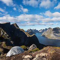 Tent camping on narrow ridge of summit of Reinebringen mountain peak, Reine, Moskenesoy, lofoten Islands, Norway