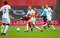 18th July 2020; Liberty Stadium, Swansea, Glamorgan, Wales; English Football League Championship, Swansea City versus Bristol City; Benik Afobe of Bristol City and Mike van der Hoorn of Swansea City jostle for possession