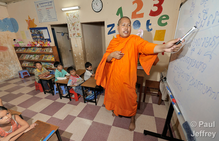 Buddhist monk Han Kimsoy teaches students--mostly orphans and other vulnerable children, many of them infected or affected by HIV and AIDS--in a school in the Beungkak neighborhood of Phnom Penh which is run by the Salvation Centre Cambodia, an organization that works with Buddhist monks and other activists to do education and advocacy and care for people infected or affected by HIV and AIDS.