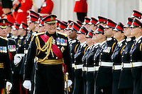 Inspection of graduate soldiers in military dress uniform at passing out parade at Sandhurst Royal Military Academy, Surrey, England