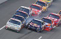 Oct 5, 2008; Talladega, AL, USA; NASCAR Sprint Cup Series driver Dale Earnmhardt Jr (88) leads the field as Brian Vickers (83) blows a tire setting off a multi-car accident during the Amp Energy 500 at the Talladega Superspeedway. Mandatory Credit: Mark J. Rebilas-