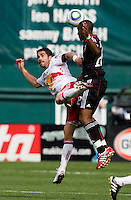 Rodney Wallace (22) of D.C. United goes up for a header with Juan Pablo Angel (9) of the New York Red Bulls at RFK Stadium in Washington, DC.  The New York Red Bulls defeated D.CC United, 2-0.