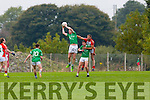 St Kieran's Seamus Scanlon catches the kick out ahead on Shane Murphy Kilcummin during their County Championship clash in Kilcummin on Saturday