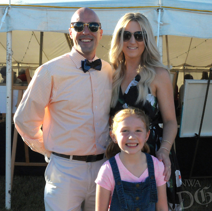 NWA Democrat-Gazette/JOCELYN MURPHY<br /> Ben Starnes and Bridget Glynn visit with Caroline Foster during the 27th annual Polo in the Ozarks, hosted at the Buell Farm in Fayetteville on Saturday, Sept. 10, 2016.