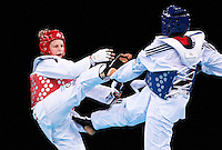 04 DEC 2011 - LONDON, GBR - Anastasia Baryshnikova (RUS) (on left, in red) battles with Gwladys Epangue (FRA) (on right, in blue) during the women's +67kg category final at the London International Taekwondo Invitational and 2012 Olympic Games test event at the ExCel Exhibition Centre in London, Great Britain .(PHOTO (C) NIGEL FARROW)