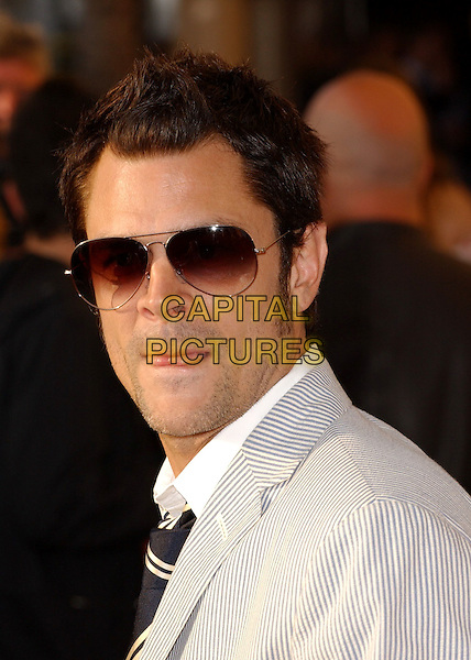 JOHNNY KNOXVILLE.Attends The 2005 MTV Movie Awards held at The Shrine Theatre in Los Angeles, California, USA, .June 4th 2005..portrait headshot sunglasses aviators beard stubble jonny funny tongue.Ref: DVS.www.capitalpictures.com.sales@capitalpictures.com.©Debbie VanStory/Capital Pictures