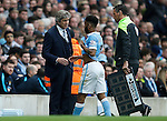 Manuel Pellegrini manager of Manchester City talks to Raheem Sterling of Manchester City as he goes off injured during the Barclays Premier League match at The Etihad Stadium. Photo credit should read: Simon Bellis/Sportimage