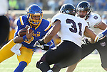 BROOKINGS, SD - NOVEMBER 5:  Taryn Christion #3 from South Dakota State is brought down by a pair of defenders including Dylan Cole #31 form Missouri State in the first half Saturday afternoon at Dana J. Dykhouse Stadium in Brookings. (Photo by Dave Eggen/Inertia)