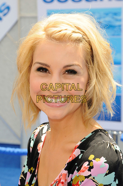 "CHELSEA STAUB.Arrivals - Disneynature's Premiere Of ""Oceans"" held At El Caitan Theatre, Hollywood, California, USA..17th April 2010.headshot portrait black pink floral print smiling .CAP/ROT.©Lee Roth/Capital Pictures"