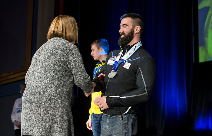 Prince George, B.-C., 16 February/2019 -  Collin Cameron receives his silver medal for finishing second in the men's middle distance sitting biathlon during the Medal ceremony  at the 2019 World Para Nordic skiing Championships in Prince George, B.C. Photo Bob Frid/Canadian Paralympic Committee.
