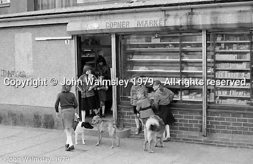 Corner shop, Wester Hailes, Scotland, 1979.  John Walmsley was Photographer in Residence at the Education Centre for three weeks in 1979.  The Education Centre was, at the time, Scotland's largest purpose built community High School open all day every day for all ages from primary to adults.  The town of Wester Hailes, a few miles to the south west of Edinburgh, was built in the early 1970s mostly of blocks of flats and high rises.