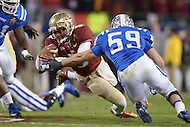 December 7, 2013  (Charlotte, North Carolina)  Florida State Seminoles quarterback Jameis Winston #5 is tackled by Duke Blue Devils linebacker Kelby Brown #59 as he ran the ball during the 2013 ACC Championship game. FSU defeated Duke 45-7. (Photo by Don Baxter/Media Images International)