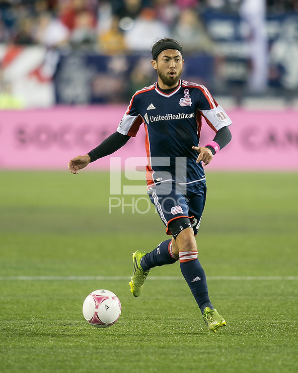 New England Revolution midfielder Lee Nguyen (24).  The New England Revolution played to a 1-1 draw against the Houston Dynamo during a Major League Soccer (MLS) match at Gillette Stadium in Foxborough, MA on September 28, 2013.