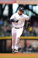 Milwaukee Brewers outfielder Carlos Gomez #27 runs the bases after hitting a home run during a game against the Minnesota Twins at Miller Park on May 27, 2013 in Milwaukee, Wisconsin.  Minnesota defeated Milwaukee 6-3.  (Mike Janes/Four Seam Images)