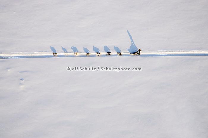 Aerial of sled dog team running on Yukon River from Nikolai to McGrath 2006 Iditarod Western Alaska