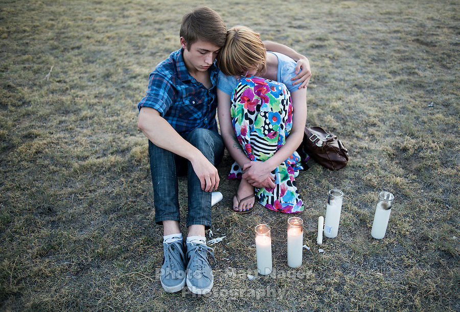 From left, Nathan Mendonca (cq), 18, and Melissa Clark (cq), 18, during a vigil held next to the Aurora Century 16 movie theater where James Holmes (cq), 24, is in custody and is suspected of killing 12 people and wounding many more in Aurora, Colorado, Friday, July 20, 2012. The shootings occurred during the midnight premiere of the new Dark Knight Batman movie...Photo by MATT NAGER