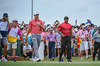 Jordan Spieth (USA) and Tiger Woods (USA) head down 1 during round 4 of The Players Championship, TPC Sawgrass, at Ponte Vedra, Florida, USA. 5/13/2018.<br /> Picture: Golffile | Ken Murray<br /> <br /> <br /> All photo usage must carry mandatory copyright credit (&copy; Golffile | Ken Murray)