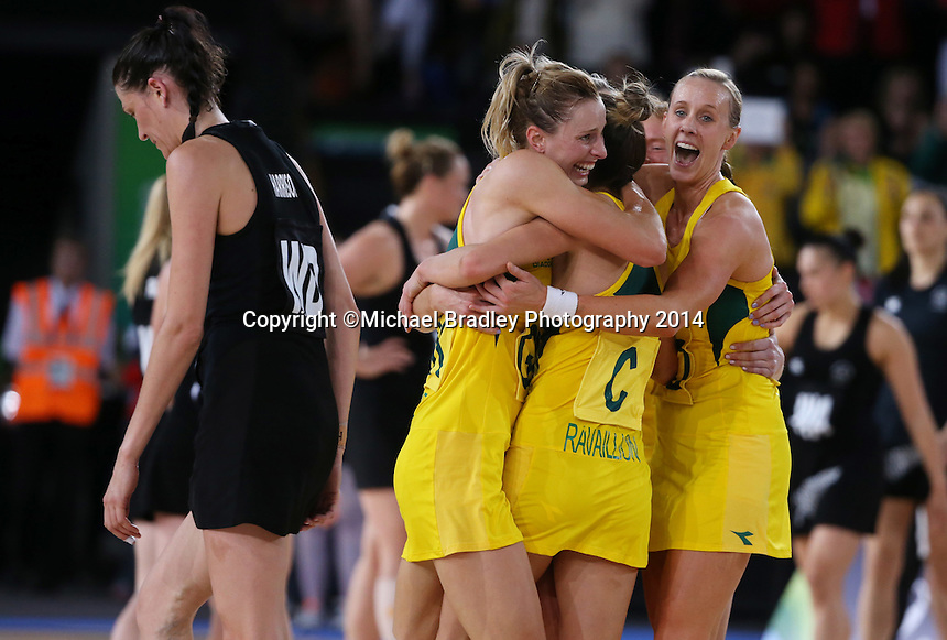 03.08.2014 Australia's Laura Geitz and team mates celebrate during the New Zealand v Australia gold netball match at the Commonwealth Games Glasgow Scotland. Mandatory Photo Credit ©Michael Bradley.