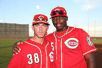 Shane Mardirosian #38 and Jonathan Martijn #25 of the AZL Reds pose together for a photo before a game against the AZL Brewers at the Cincinnati Reds Spring Training Complex on July 5, 2014 in Goodyear Arizona. AZL Reds defeated the AZL Brewers, 7-2. (Larry Goren/Four Seam Images)