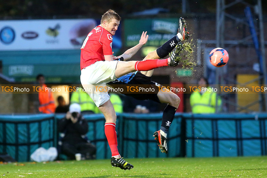 Adam Dugdale clears the ball for Crewe - Wycombe Wanderers vs Crewe Alexandra - FA Cup 1st Round Football at Adams Park, High Wycombe, Buckinghamshire - 09/11/13 - MANDATORY CREDIT: Paul Dennis/TGSPHOTO - Self billing applies where appropriate - 0845 094 6026 - contact@tgsphoto.co.uk - NO UNPAID USE