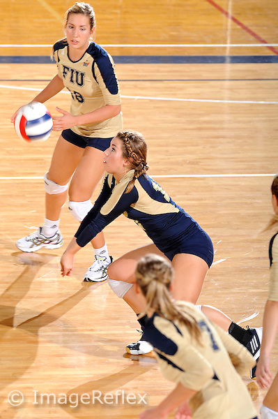 11 September 2011:  FIU defensive specialist/libero Carolyn Fouts (17) keeps the ball in play as outside hitter Jovana Bjelica (16) watches in the second set as the FIU Golden Panthers defeated the Florida A&M University Rattlers, 3-0 (25-10, 25-23, 26-24), at U.S Century Bank Arena in Miami, Florida.