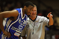 Umpire Sean Cronin talks to Ernest Scott during a break in play during the NBL Round 14 basketball match between the Wellington Saints and Auckland Stars at TSB Bank Arena, Wellington, New Zealand on Thursday 29 May 2008. Photo: Dave Lintott / lintottphoto.co.nz