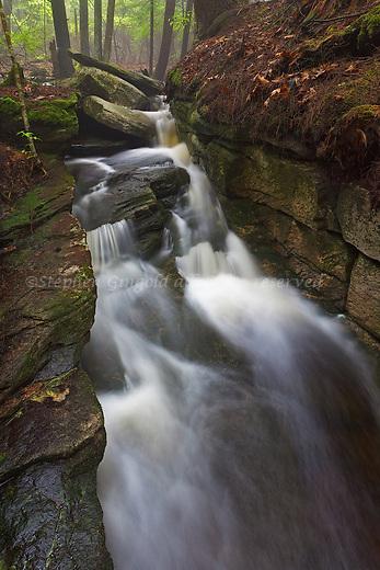 A cascade tumbles through a wall of rocks along Amethyst Brook in Pelham, MA.