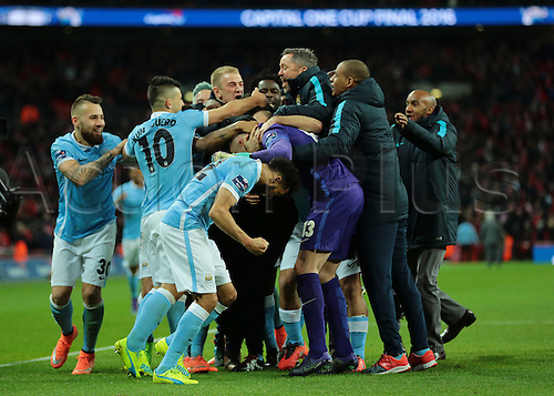 28.02.2016. Wembley Stadium, London, England. Capital One Cup Final. Manchester City versus Liverpool. Manchester City players surround Manchester City Goalkeeper Wilfredo Caballero after his saves win the penalty shoot out for Manchester City