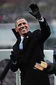 United States President Barack Obama waves during the presidential inauguration on the West Front of the U.S. Capitol January 21, 2013 in Washington, DC.   Barack Obama was re-elected for a second term as President of the United States.       .Credit: Win McNamee / Pool via CNP