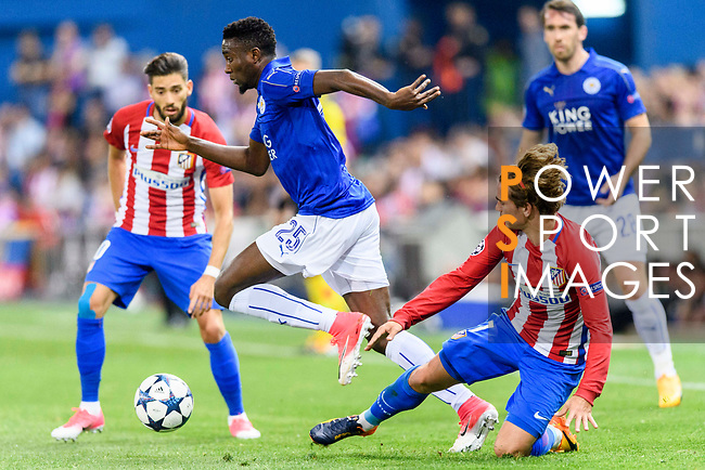 Wilfred Ndidi (c) of Leicester City fights for the ball with Antoine Griezmann (r) of Atletico de Madrid during their 2016-17 UEFA Champions League Quarter-Finals 1st leg match between Atletico de Madrid and Leicester City at the Estadio Vicente Calderon on 12 April 2017 in Madrid, Spain. Photo by Diego Gonzalez Souto / Power Sport Images