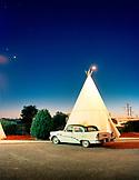 USA, Arizona, Holbrook, classic car parked by teepee, Wigwam Motel