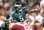 Philadelphia Eagles quarterback Donovan McNabb (5) re-positions a player in game action against the Washington Redskins in Landover, Maryland on December 12, 2004.  The Eagles won the game 17 -14..Credit: Ron Sachs / CNP