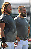 Ryan Fitzpatrick #14, right, sports a new haircut as he stands alongside teammate #74 Nick Mangold after a day of New York Jets training camp at Atlantic Health Jets Training Center in Florham Park, NJ on Wednesday, Aug. 3, 2016.