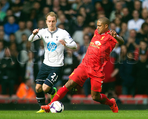 30.03.2014  Liverpool, England. Liverpool's Glen Johnson and Tottenham's  Christian Eriksen during the Premier League game between Liverpool and Tottenham Hotspur from Anfield