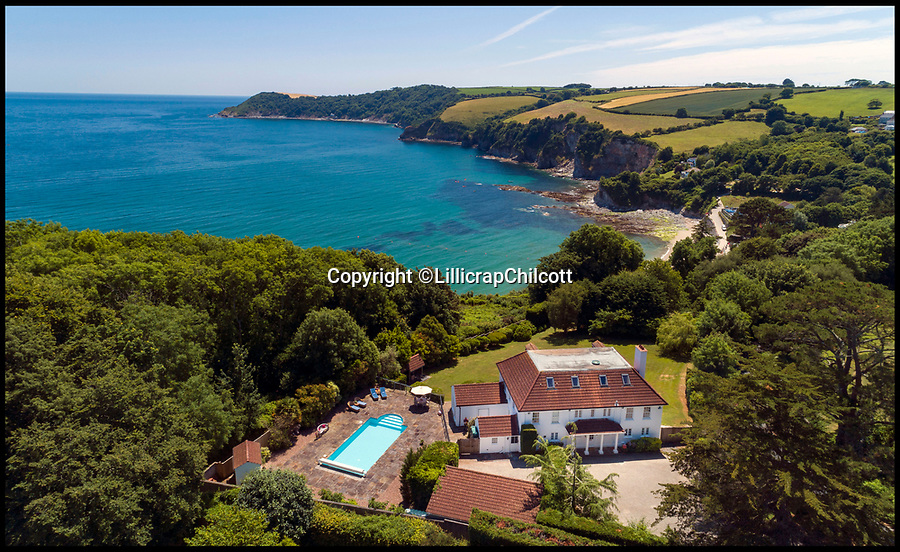 BNPS.co.uk (01202 558833)<br /> Pic: LillicrapChilcott/BNPS<br /> <br /> Room with a view...<br /> <br /> With its crystal clear azure waters and sandy beach, people could mistake this coastal home for somewhere in the Mediterranean but the aptly named Blue Waters - on the market for £1.85m - is actually in Cornwall.<br /> <br /> The elegant 1920s house is in a prized position on the sought-after 'Cornish Riviera' - so called because of the calm clear waters on the south coast of Cornwall near St Austell.<br /> <br /> Blue Waters has the best of both worlds as it is in an incredibly private setting directly above the pretty Porthpean Beach, with easy access through a garden gate to the coastal path.<br /> <br /> The property, on the market with Lillicrap Chilcott, has outstanding views across St Austell Bay and along Black Head, as well as out across the English Channel.