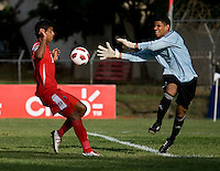 Sandy Sanchez (1) of Cuba reaches out for the ball as Jorman Aguilar (18) of Panama  closes in during the group stage of the CONCACAF Men's Under 17 Championship at Jarrett Park in Montego Bay, Jamaica. Panama tied Cuba, 0-0.