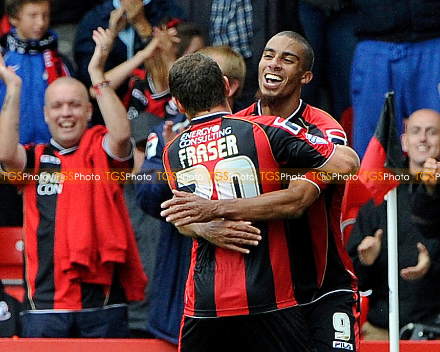 Lewis Grabban of AFC Bournemouth is congratulated by Ryan Fraser of AFC Bournemouth after scoring his goal - AFC Bournemouth vs Wigan Athletic - Sky Bet Championship Football at Goldsands Stadium, Bournemouth, Dorset - 17/08/13 - MANDATORY CREDIT: Denis Murphy/TGSPHOTO - Self billing applies where appropriate - 0845 094 6026 - contact@tgsphoto.co.uk - NO UNPAID USE
