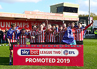 Lincoln City players celebrate promotion at the end of the game<br /> <br /> Photographer Andrew Vaughan/CameraSport<br /> <br /> The EFL Sky Bet League Two - Lincoln City v Cheltenham Town - Saturday 13th April 2019 - Sincil Bank - Lincoln<br /> <br /> World Copyright &copy; 2019 CameraSport. All rights reserved. 43 Linden Ave. Countesthorpe. Leicester. England. LE8 5PG - Tel: +44 (0) 116 277 4147 - admin@camerasport.com - www.camerasport.com