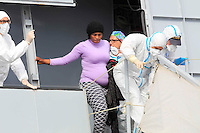 a Pregnant stand on the board of  the Italian Navy vessel 'Bettica' before disembarking  in the harbor of Salerno, Italy, 05 May, 2015